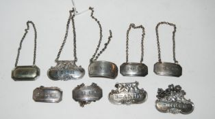 """A lot comprising a set of three silver decanter labels, Glasgow 1826 """"Shrub"""", """"Brandy"""", """"Rum"""" with a"""