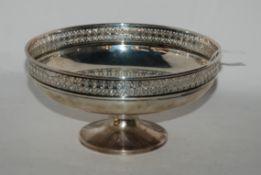 A silver pedestal bowl, Sheffield 1927, circular with pierced decoration, 20.5cm diameter, 388gms