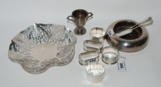 A lot comprising a silver dish with pierced decoration, three silver napkin rings, a small silver