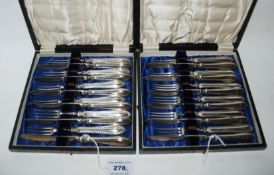 A lot comprising two cased twelve piece sets of silver handled dessert knives and forks, Sheffield