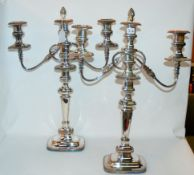 A pair of silver plated three-light candelabra, 55cm high Condition Report: Available upon request