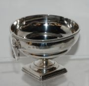 A silver bowl, Edinburgh 1926, with gadrooned rim and twin lion's mask handles on square gadrooned