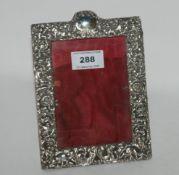A silver mounted photo frame, Birmingham 1927, 18cm x 11cm, aperture 13cm x 19cm Condition Report: