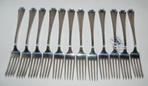 A part sterling silver cutlery set by Spaulding & Co comprising twelve dinner forks, twelve