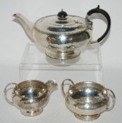 A hammered silver three piece tea service, Sheffield 1925, 936gms Condition Report: Available upon