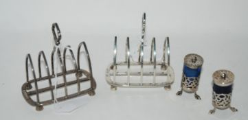 A lot comprising a pair of silver toastracks, London 1938 and a pair of silver mounted blue glass