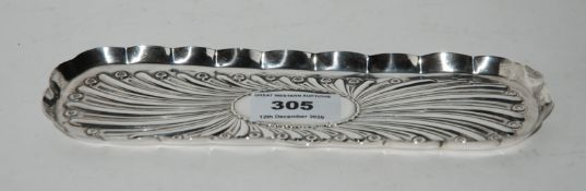 A silver dressing table dish, tidy, London marks, 21.5cm x 7.5cm, 79gms Condition Report: