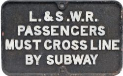 LSWR cast iron sign L&SWR PASSENGERS MUST CROSS LINE BY SUBWAY measuring 25.5in x 16in. In as