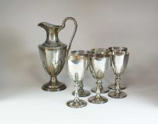 A silver wine ewer and six silver goblets