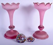 TWO VINTAGE GLASS PAPERWEIGHTS together with a pair of pink opaque glass lustres. Largest 30 cm hig