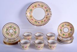 A 19TH CENTURY CONTINENTAL PORCELAIN TEASET painted with flowers upon a cream ground. Largest 24 cm