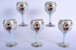FIVE UNUSUAL VINTAGE MIDDLE EASTERN BLUE GOBLETS decorated with portraits. 14.5 cm high.