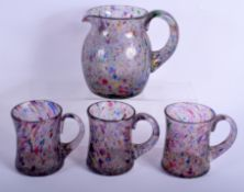 AN UNUSUAL VINTAGE ART GLASS PITCHER with three matching glasses. Largest 16 cm x 12 cm. (4)