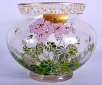 AN ART NOUVEAU ENAMELLED GLASS VASE painted with foliage and bees. 18 cm x 16 cm.