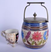 A VICTORIAN AESTHETIC MOVEMENT BISCUIT BARREL together with a Meissen style cup. 23 cm high inc han