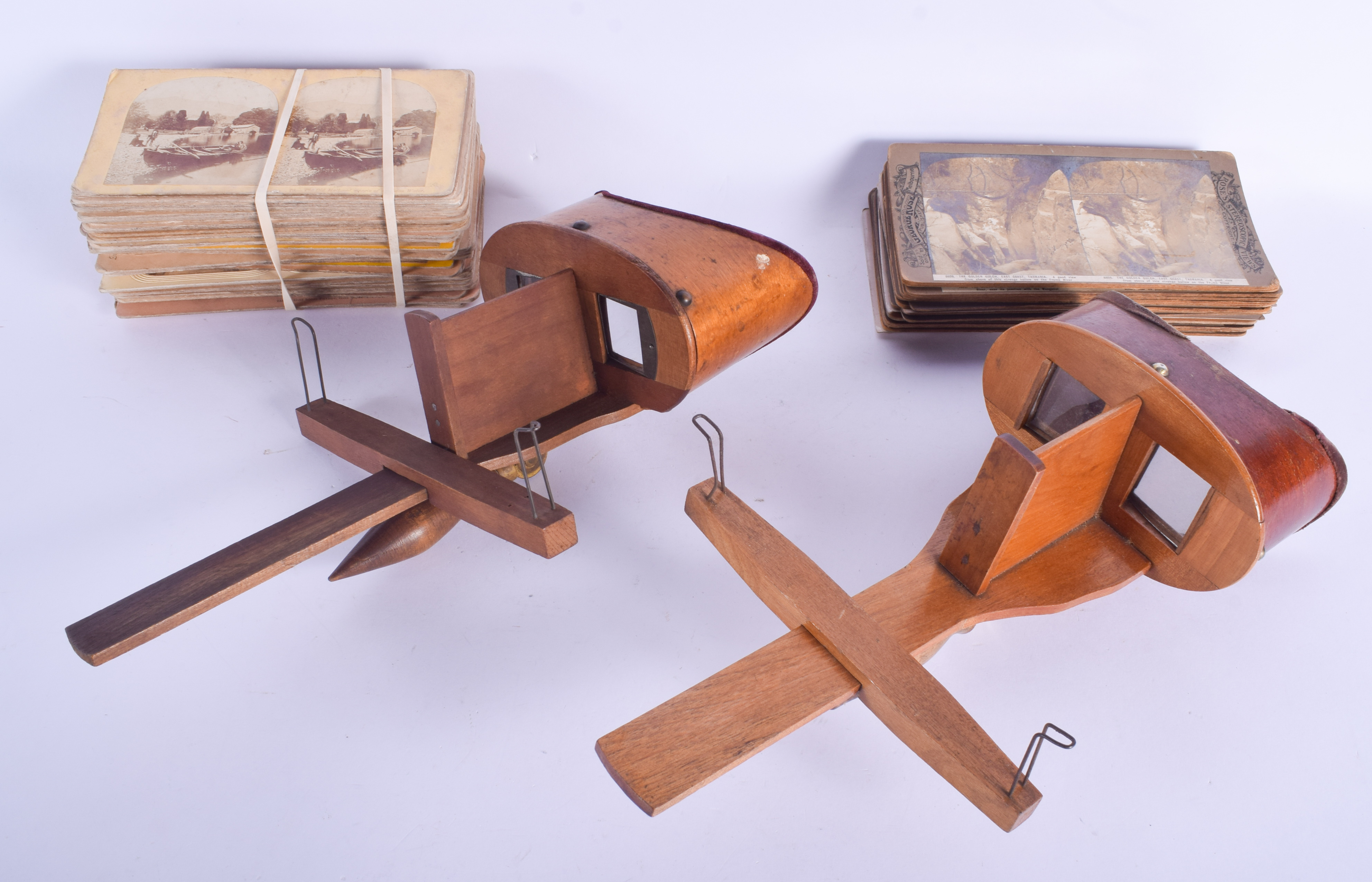 TWO VINTAGE STEREOSCOPE VIEWERS together with slides. (qty)