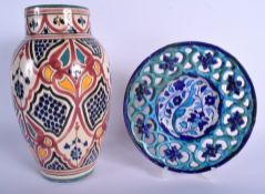 A MIDDLE EASTERN IZNIK FAIENCE TYPE POTTERY VASE together with a similar open work dish. Largest 30