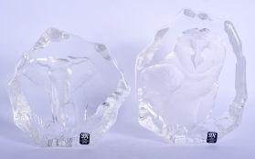 A PAIR OF MATS JONASSON SWEDISH LEAD CRYSTAL GLASS BOOK ENDS. 16 cm x 11 cm.