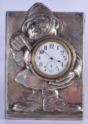 A VERY RARE SILVER NOVELTY POLICEMAN DESK CLOCK by M & C Lister. Birmingham 1908. 246 grams inc wood