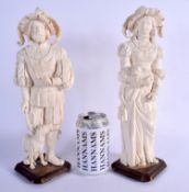 A LARGE PAIR OF 19TH CENTURY EUROPEAN DIEPPE CARVED IVORY FIGURES modelled upon wood bases. 33 cm hi