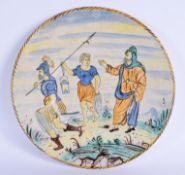 A LARGE 19TH CENTURY CONTINENTAL MAJOLICA FAIENCE DISH painted with figures. 36 cm diameter.