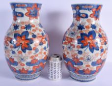 A LARGE PAIR OF 19TH CENTURY JAPANESE MEIJI PERIOD IMARI VASES painted with flowers. 37 cm x 15 cm.