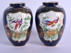 A PAIR OF ANTIQUE BOOTHS BLUE SCALE VASES. 12.5 cm high.