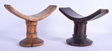 TWO AFRICAN TRIBAL CARVED WOOD HEAD RESTS. 16 cm x 21 cm. (2)