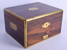 AN EARLY 19TH CENTURY SILVER CAMPAIGN TYPE DRESSING TABLE BOX with fitted interior. London 1837. Box