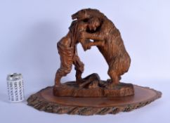 A RARE EARLY 20TH CENTURY BAVARIAN BLACK FOREST CARVED WOOD FIGURAL GROUP depicting a bear wrestling