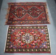 TWO VINTAGE SMALL RUGS. Largest 110 cm x 65 cm. (2)