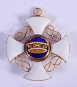 AN 18CT GOLD AND ENAMEL MEDALLION. 7.8 grams. 3.25 cm wide.