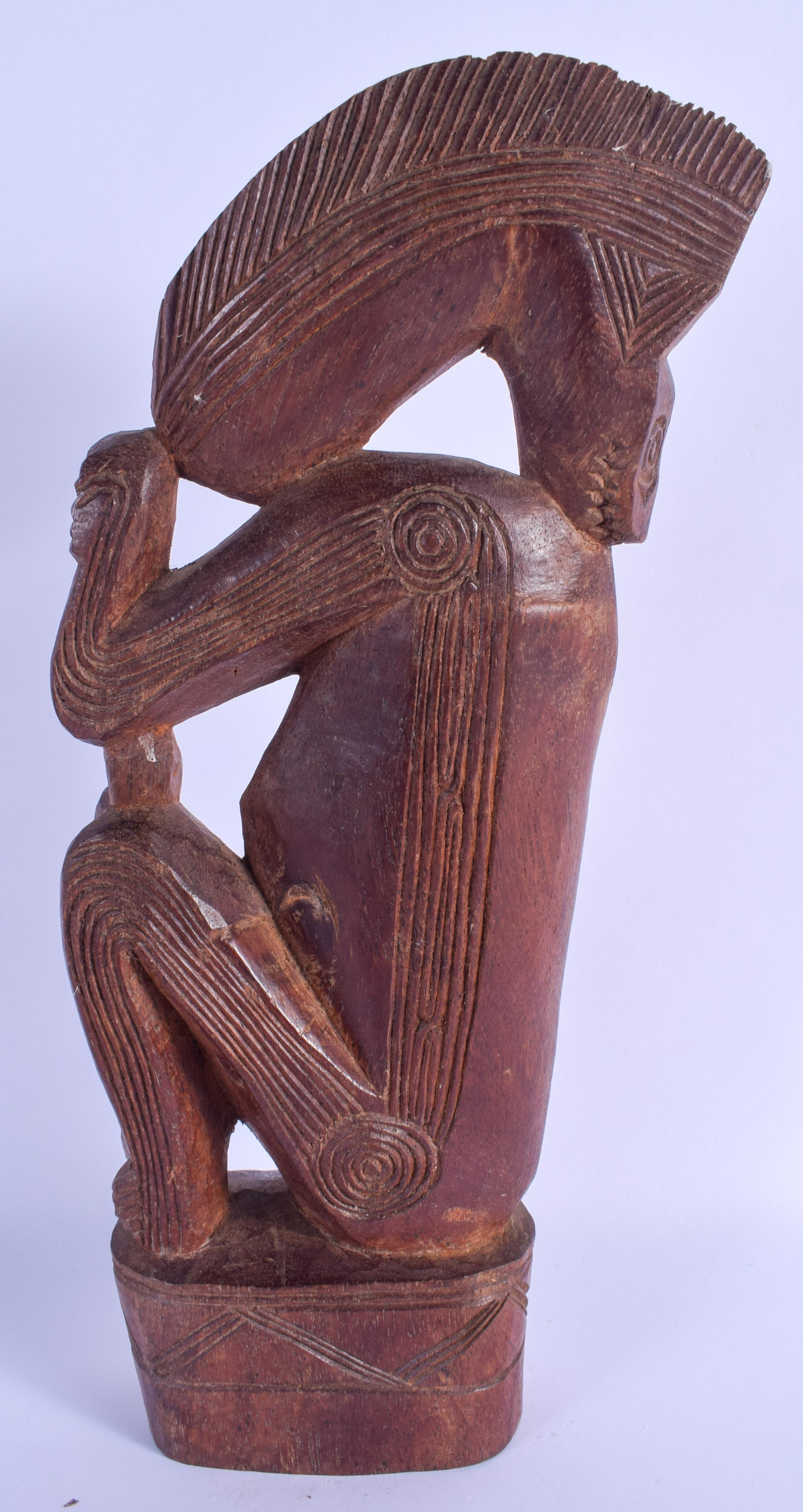 AN UNUSUAL TRIBAL CARVED HARDWOOD FIGURE OF AN ANIMAL possibly Papua New Guinea, Sepik 32 cm x 11 cm