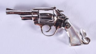 A SILVER AND MOTHER OF PEARL PISTOL. 5 cm wide.