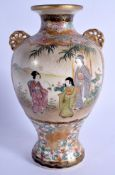 A 19TH CENTURY JAPANESE MEIJI PERIOD SATSUMA VASE painted with geisha. 16.5 cm high.