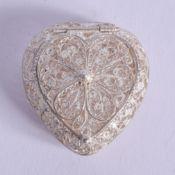 A SILVER FILIGREE HEART SHAPED BOX. 9 grams. 3 cm x 3.5 cm.