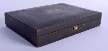 AN ANTIQUE MOROCCAN LEATHER ROYAL PATENT CRESTED BOX. 30 cm x 22 cm.