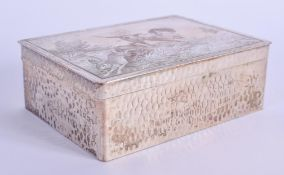 AN ART DECO SILVER PLATED COPPER BOX AND COVER decorated with hounds. 10 cm x 7.5 cm.