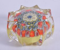 A VINTAGE GLASS PAPERWEIGHT. 4 cm wide.