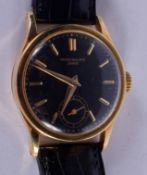 A RARE 18CT GOLD PATEK PHILIPPE BLACK DIAL WRISTWATCH with 18ct gold strap. Dial 3 cm diameter, Stra