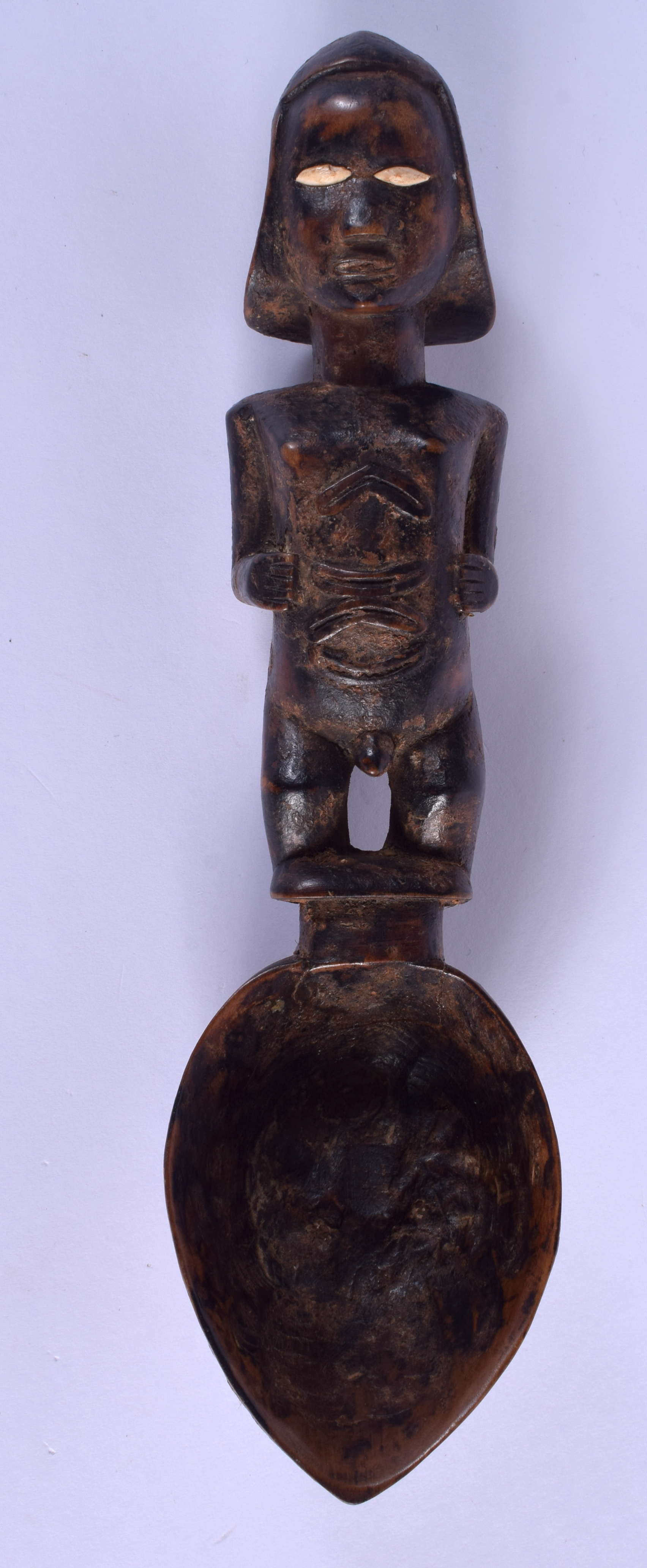 AN AFRICAN TRIBAL COFFEE BEAN EYED CARVED WOOD FIGURAL SPOON. 24 cm long.