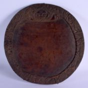 AN AFRICAN TRIBAL DIVINATION CARVED WOOD PLATE. 40 cm x 43 cm.