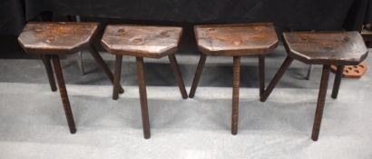 FOUR STYLISH VINTAGE THREE LEGGED CUTLERS STOOLS. 51 cm x 39 cm. (4)