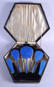 A CHARMING ART DECO SILVER PLATED AND ENAMEL DRESSING TABLE SET. Largest 24 cm x 10 cm. (5)