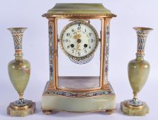 AN ANTIQUE FRENCH ONYX AND CHAMPLEVE ENAMEL CLOCK GARNITURE. Mantel 33 cm x 17 cm. (3)