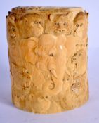 A 19TH CENTURY JAPANESE MEIJI PERIOD CARVED IVORY TUSK VASE AND COVER decorated with animals. 12 cm