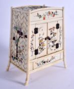 A 19TH CENTURY JAPANESE MEIJI PERIOD CARVED SHIBAYAMA IVORY CABINET decorated with foliage and vines