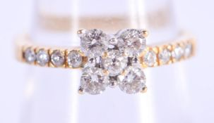 AN 18CT GOLD AND DIAMOND RING. M. 3.6 grams.