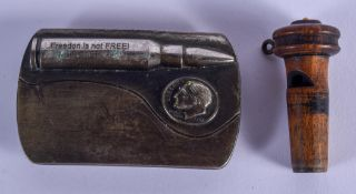 AN AMERICAN SILVER PLATED AMMO VETERAN BUCKLE together with a treen whistle. Largest 10 cm x 5 cm. (