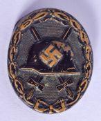 A GERMAN MILITARY HELMET BADGE. 4.5 cm wide.